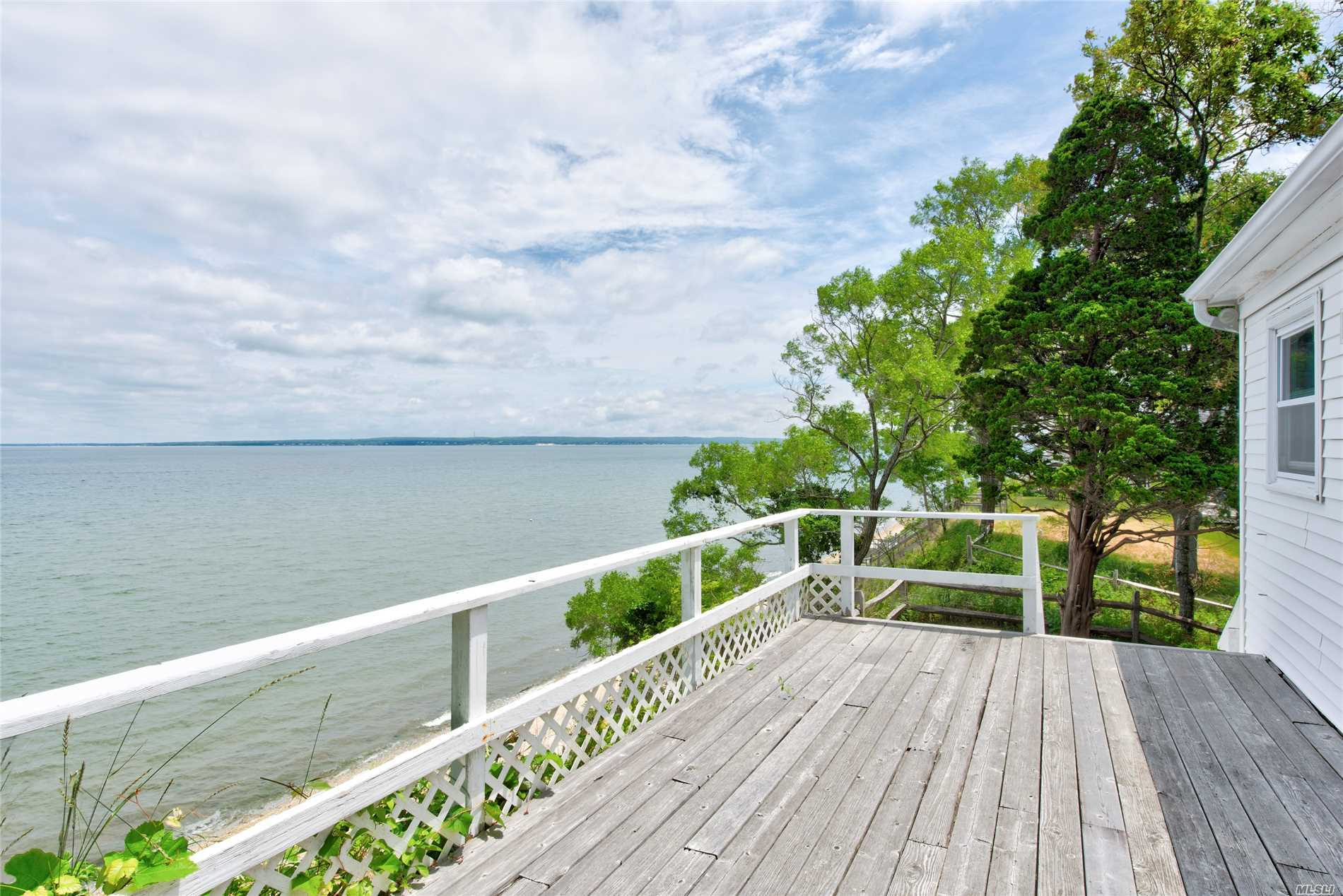 North fork Waterfront property with private Beach on Nassau Point, perfect for water sports, windsurfing, paddle boarding, swimming & canoeing. Main House plus guest house cottage all with direct access to beautiful Peconic bay.