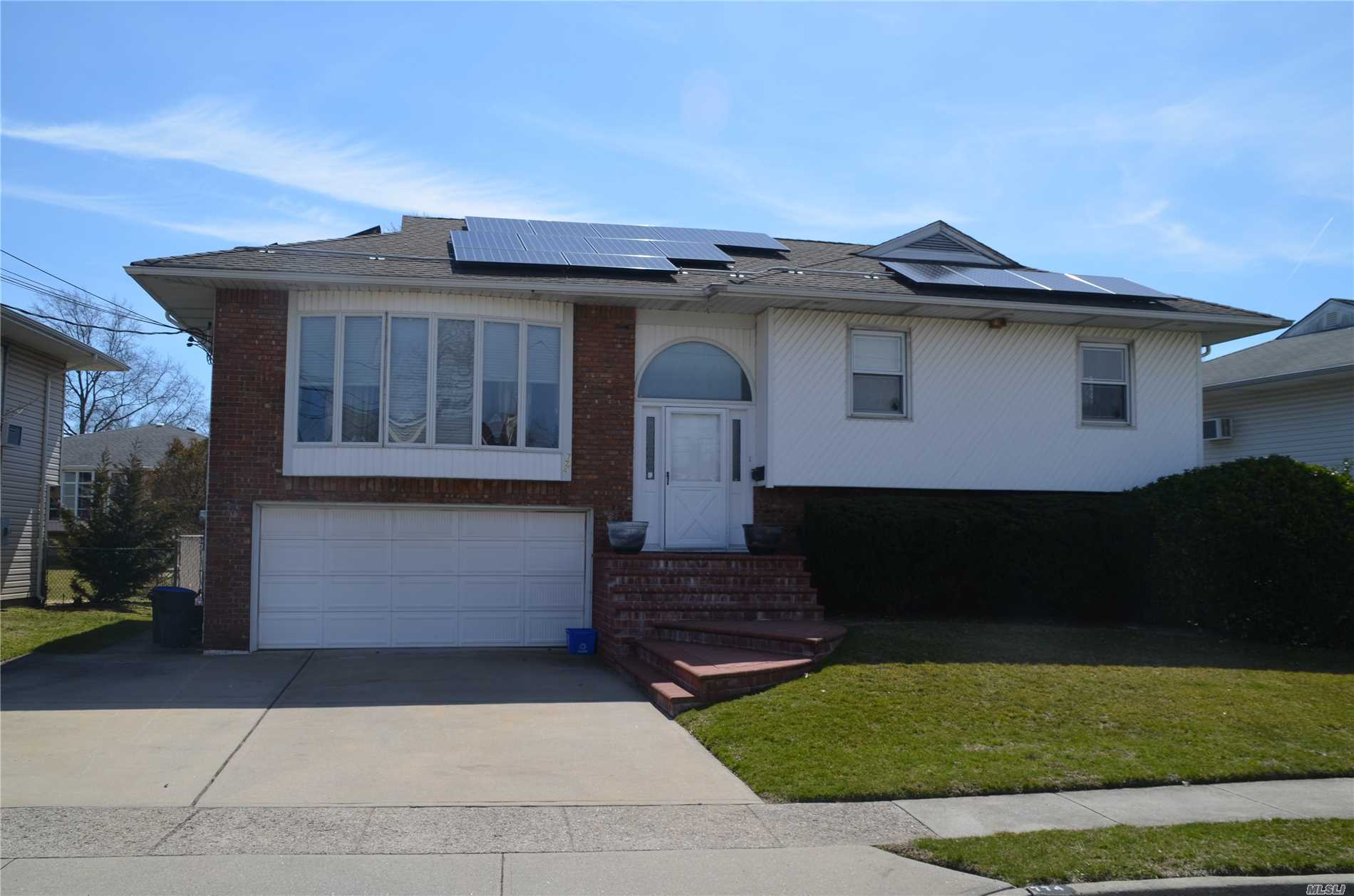 WHY PAY FOR ELECTRIC?  Full Solar Panel Roof System. Large Expanded Wide Line High Ranch, situated on a side street, blocks to the Middle & Elementary Schools, and Award Winning Baldwin Park. This home features 5 BRs, 3 FBaths, Large Open EIK, Solar Panels & Family Room. Possible Mother /Daughter with proper permits.