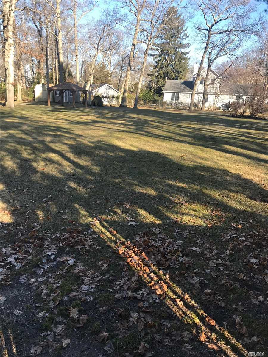 Beautiful Large Completely Fenced Property In Desirable E. Patchogue .Cleared And Leveled Ready To Build, Close To Great South Bay.Easy Show