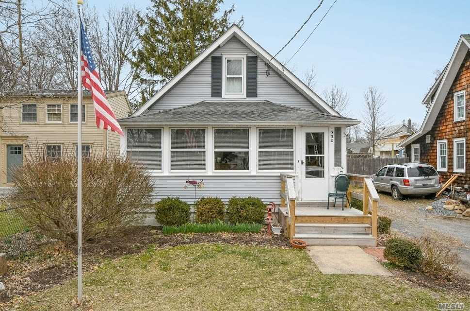 Lovely 1-2 Bedroom Home Features a Prime Location Moments to the Water and Village With 2 Enclosed Porches (Renovated), Formal Dining Room, Living Room, Kitchen, Full Bath, Updated Heating, Updated Siding, Big Backyard w/Fence, Garage/Shed and More!