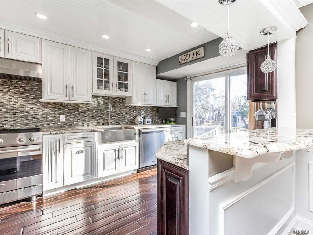 Attention To Detail Abounds In This 3br/1.5bth Split Set On A Private .63 Acre. High-End Kitchen W/White Cabinets, Viking Appliances (Gas Cooking), Granite & Unique Under Cabinet Lighting. Decorative Mouldings Thru-Out. Custom Fireplace. Solid Wood Doors. Gleaming Wood Floors. New Triple Pane Windows. Cac. 27 Hi-Hats. Family Rm W/Sliders To Patio ~ Great For Outside Entertaining! Be The Proud Owner...