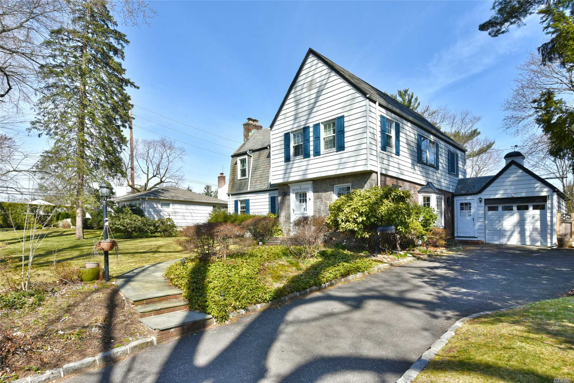 Revamped, reinvented & ready to sell. Spring has sprung! Magic is in the air as you enter into this glamorous picture perfect stone and shingle colonial. Unbelievable opportunity with an express commute to Manhattan on the sought after Port Washington line. Boasting sun filled rooms and charm, newly renovated kitchen with granite counter tops and stainless appliances, remodeled baths, beautiful hardwood floors throughout. **Taxes will be reduced 13.30%** Roslyn SD, Port Wash Train Sticker!