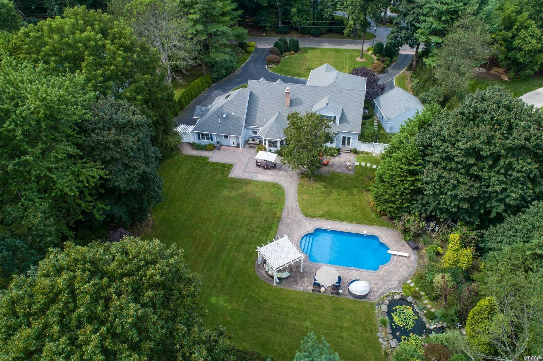 Picturesque Colonial w/ front porch set back on a manicured 2 acres in one of the most sought-after locations in Cold Spring Harbor. Impressive 2-story foyer & 23'x14' eat-in kitchen w/ sun-filled breakfast area. 1st fl includes separate guest wing plus master ensuite w/walk-in closet, sitting rm & French doors to yard. Enjoy every day living in backyard oasis, saltwater pool, Koi pond, expansive patio & sweeping level lawn. Convenient to village, train & Eagle Dock Beach w/ mooring rgts (fee).