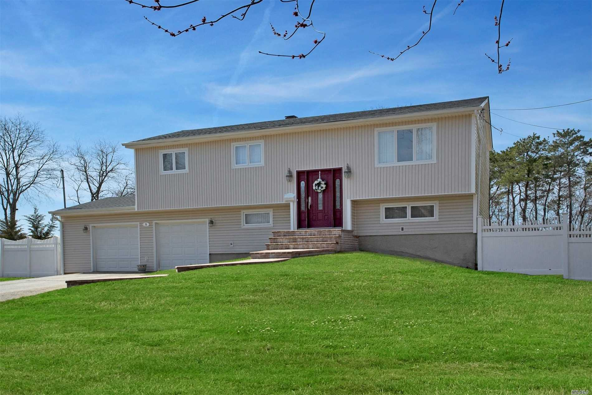 Beautiful 4 BR, 2 Bath Hi Ranch on .73 Acres W/2 car garage. This home offers gas heat and gas cooking.Remodeled kitchen with ceramic tile floor and back splash, Quartz countertop and stainless steel appliances.Updated windows, roof, vinyl siding & downstairs bath.Hardwood floors upstairs.Den W/custom shutters on window and sliders. Wonderful yard with a basketball court, swing set, paved patio, built in Fire Pit & In-Ground-Sprinklers. Move right in!