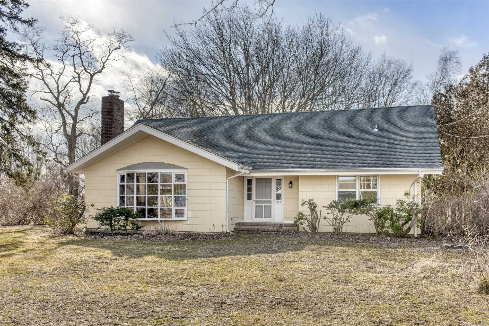 Mid Century style home in the heart of Orient Village. Large open common area, wood burning brick fireplace, hardwood floors, sun room, full basement. Close to all Village amenities - yacht club, marina & beaches. Room for a pool.