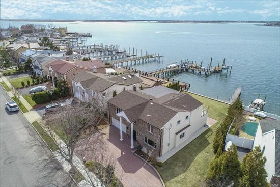 welcome into this beautiful gut renovated prime waterfront estate that offers 4 bedroom 2.5 bath, eat in gourmet kitchen, oversized family room with fire place, master suite with terrace that overlooks magnificent water views and much more.