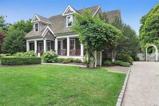 Beautiful Quogue South home on a quiet private lane. The mahogany front porch with tranquil rocking chairs welcomes you. The 1st floor includes a living room with a soaring cathedral ceiling, a great room with chef's eat-in-kitchen and top-of-the line appliances, a dining area and laundry room. A 1st floor master suite with a sitting area completes the lower level. The 2nd floor includes 3 en suite bedrooms and a 4th guest bedroom. The backyard hosts a heated gunite pool. Close to Quogue Beach.