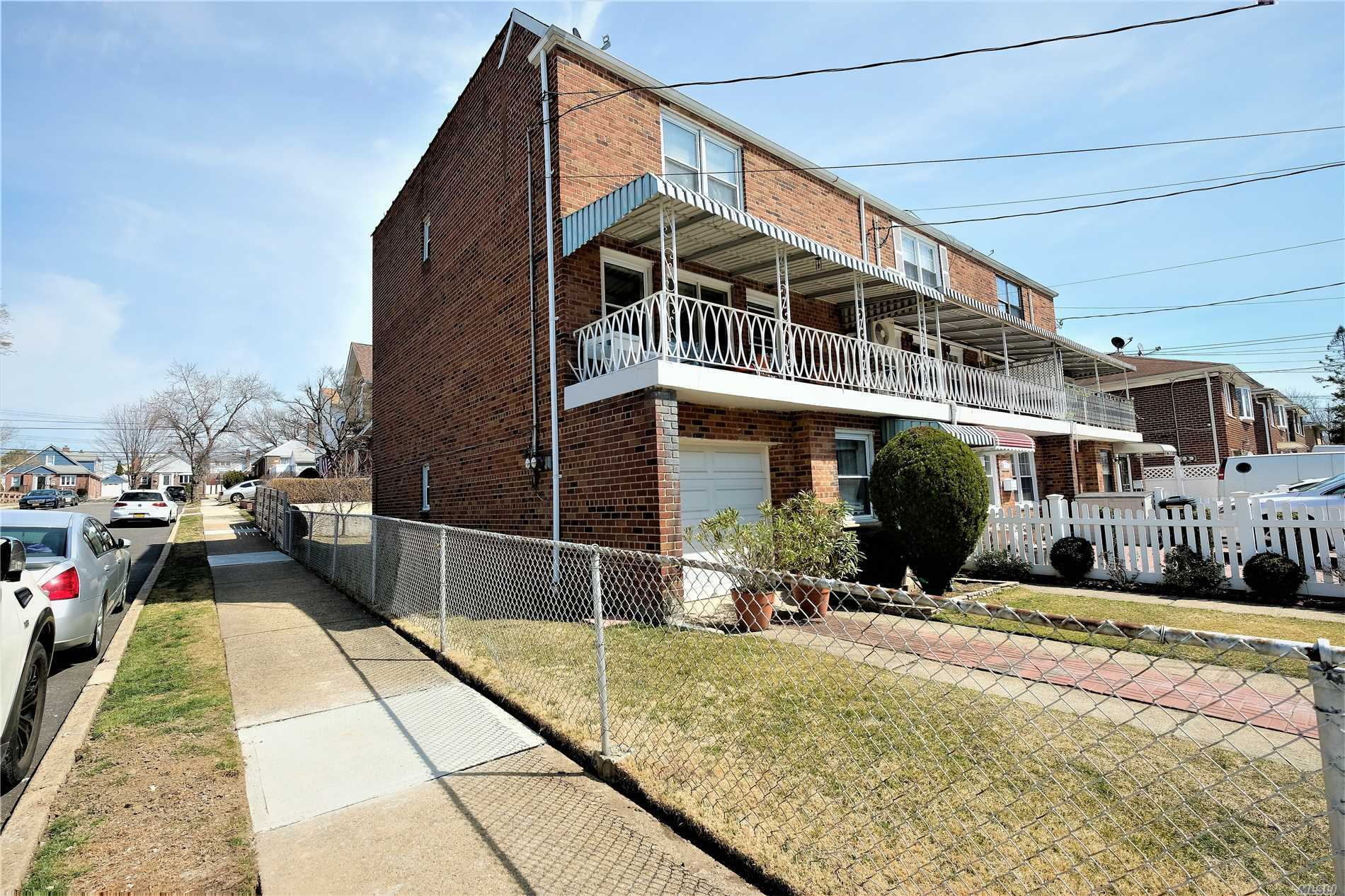Well Kept True LEGAL 2 Family Semi-Detach Full Brick in Fresh Meadow/Flushing. South West Exposure, Income Producing 1st floor 1 bedroom w/ Eat in Kitchen (Can 2nd bedroom) . 2nd & 3rd Floor Duplex 3 bedroom Suite w/ Balcony Living room, Dining Room, Full Bathroom, 3 full sized-bedroom on 3rd floor. This is a Must See Well Kept w/ Indoor Garage & private driveway. Full Basement, Family Room & Laundry room. PS 107 & JHS 216. Buss Q31. 2 Zoned Gas heat. Rear Entrance to 2nd floor Privacy.