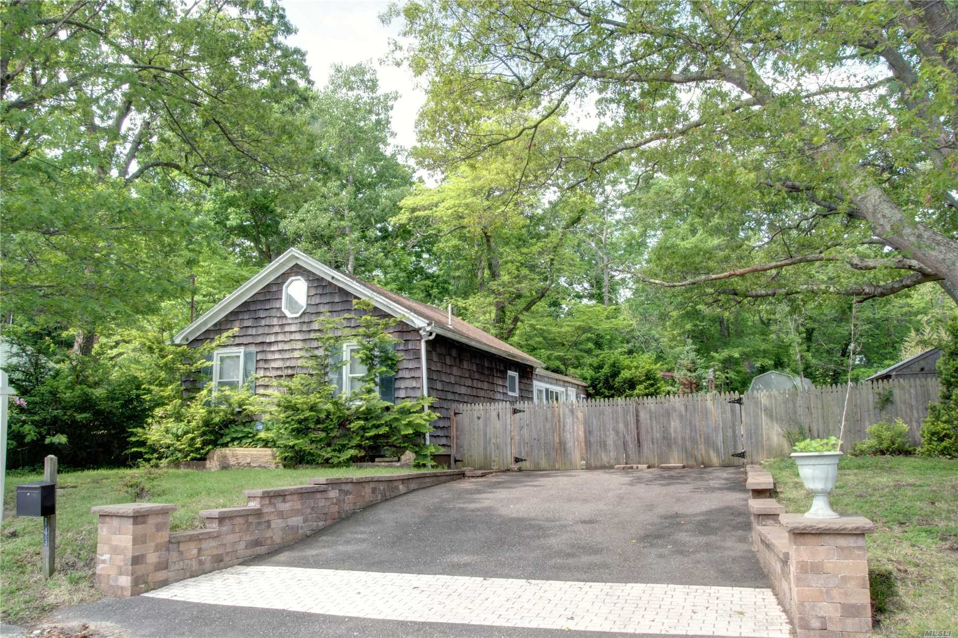 Beautiful Property .32 acres goes from Friendship Dr to Twilight. Fenced in yard with rear deck with waterviews, This Cute and Cozy Ranch is just 500' to North Shore Beaches where you can enjoy fishing, kayaking or just a lazy day at the beach, Home features newly redone hardwood floors, Eik w/SS appliances, Most rooms freshly painted. This home is a perfect Starter or retirement home or an amazing weekend get away with the beach at the end of the street. Don't miss this opportunity !!