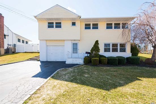 Updated Home With Very Nice Fenced In Yard. Syosset Schools. Very close to train and shops