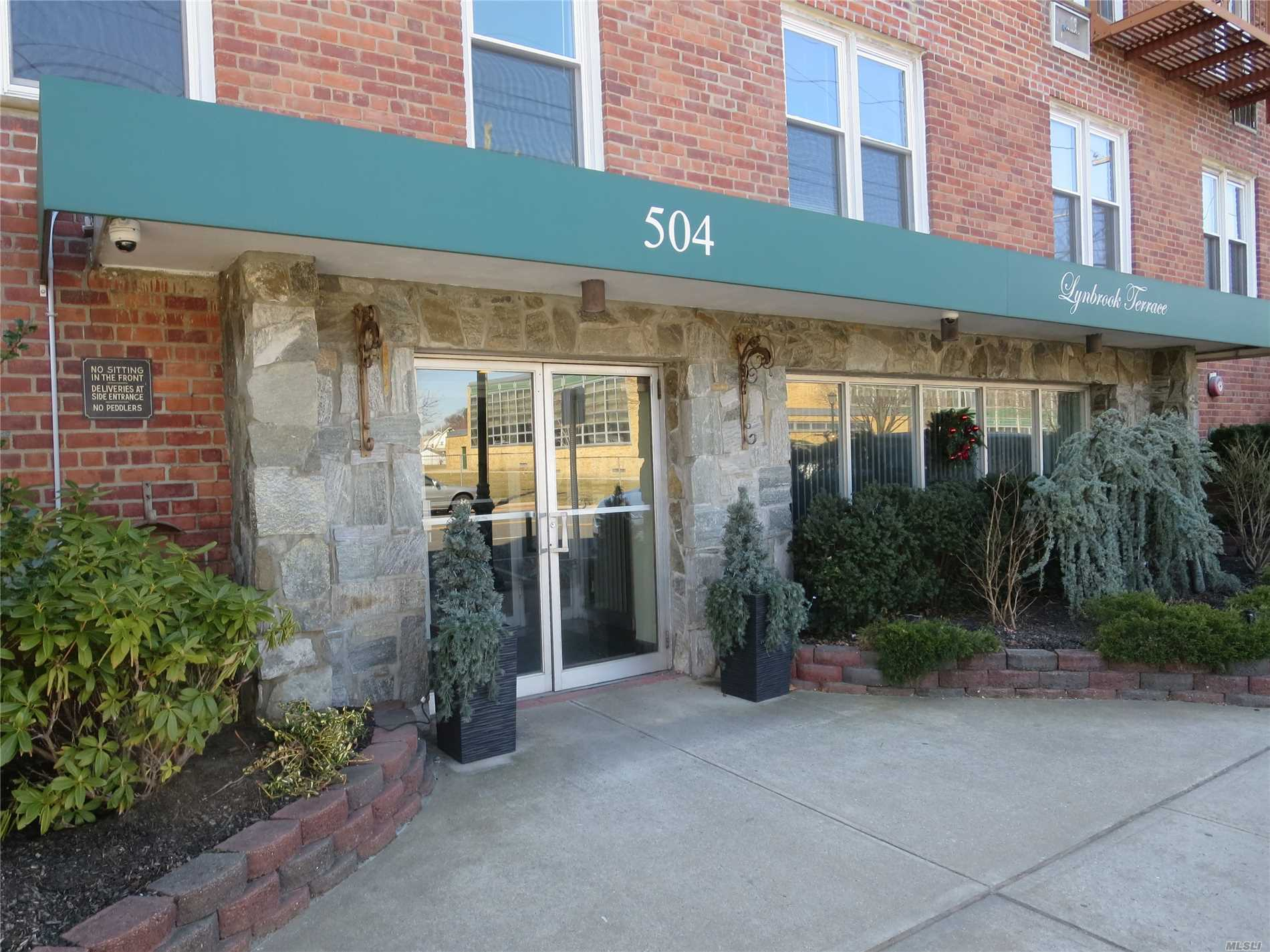 Lynbrook Studio Co-op. Entrance Foyer with Closet, Large Living Area, Updated Efficiency Kitchen and New Bath with Hall Closet. Laundry Room on Main Floor of Building. Barbecue Patio in Rear of Building.