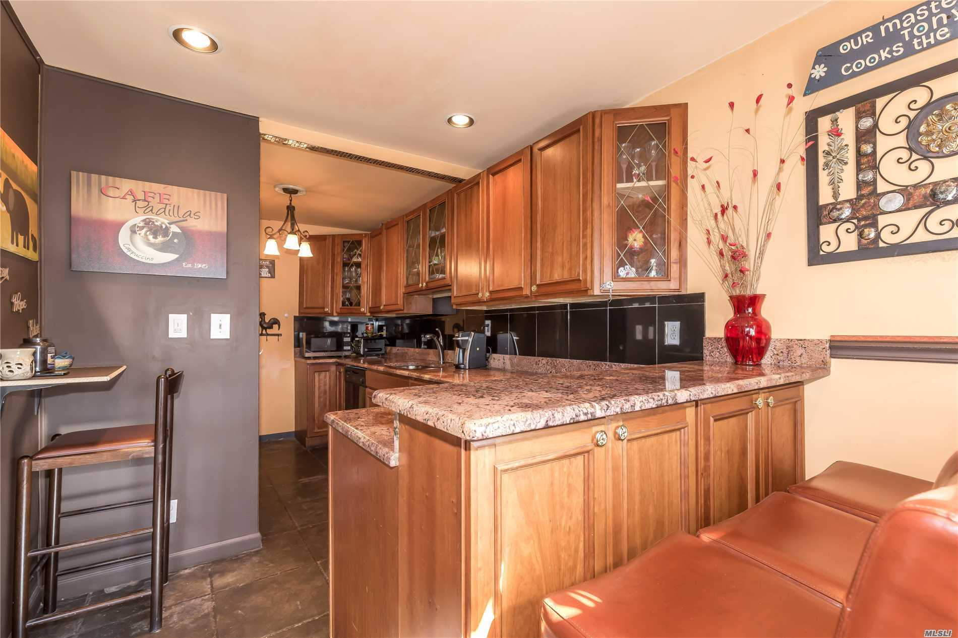 Location, Location, Location! Lovely Brick Ranch, a perfect starter home in the center of Bayside. SD # 26, full basement, cac, large driveway and nice yard. Beautiful kitchen with granite counter tops.