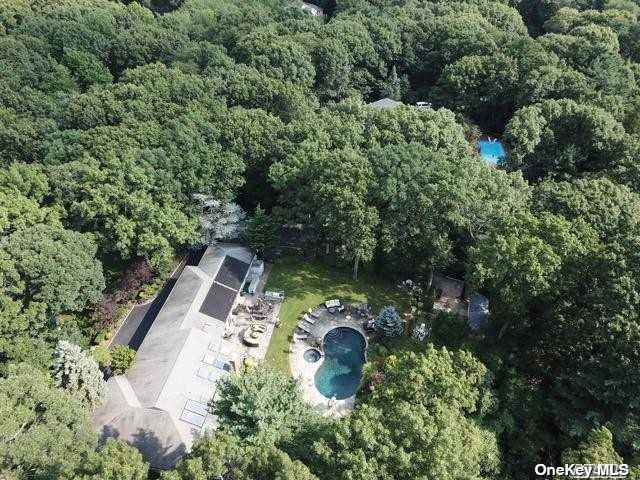 Oyster Bay Cove, Pristine Ranch, private neighborhood 2 + acres. Circular driveway 5 bed, 3.5 bath, large eat in kitchen, granite counters, gas cooking & stainless steel appliances. Den has a beautiful wood burning fireplace with walls of windows overlooking the country club yard with flagstone gunite solar heated pool, spa, waterfall & fire pit, Solar HW full Home generator. Full Finished basement with half bath, Sound proof music studio. Boasts one of the lowest property tax. Syosset School