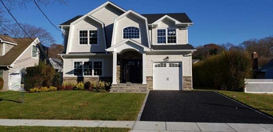 To Be Built! Time to customize! Picture yourself living in this beautiful, Bright brand new, Hampton's style home! Situated on desirable, mid-block location. Village Elementary School. Close to Rail Road, Town and parkways. Custom, gorgeous millwork, Gourmet Eat in kitchen, hardwood floors, CAC, Vaulted entry foyer, 9' basement ceilings with outside entrance...Let us help you customize your dream home!