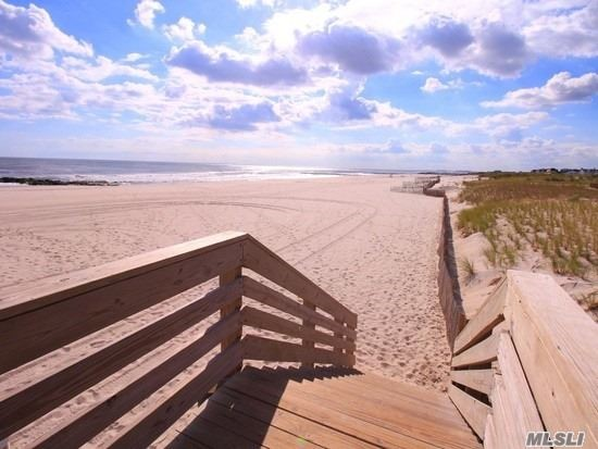5Br 2 Bth Beach Front Hi Ranch, West End Beach Side Dead End Block. Wide Open Ocean Views From Front Porch Facing West For Sunset. Easement Parking For 2-3 Cars In Addition To Garage. Lower Level Has Separate Entrance. Full Stand Up Attic. Beach Passes For Free Every Year For Nevada Beach Side Residents Only! Brand New Playground & Basketball Courts. Additional street parking Also.