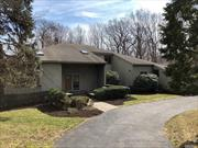 Nestled in the quiet hills of Lloyd Neck Estates, on 2.3 acres of land this Contemporary home boasts many features. Kitchen w/eik area, Formal Dining Rm, Den, Living Rm w/Fireplace. Lg. Master Br, ensuite Bath Rm and walk in closet. All w/windowed scenic views of back yard property. Lower Level, features Lg. Finished Den, Entertainment and Play areas, Lg. Storage area. Generator, LP Gas, 2) 200 amp Elec. panels, Water filtration Sys. Beach and Mooring Rights.