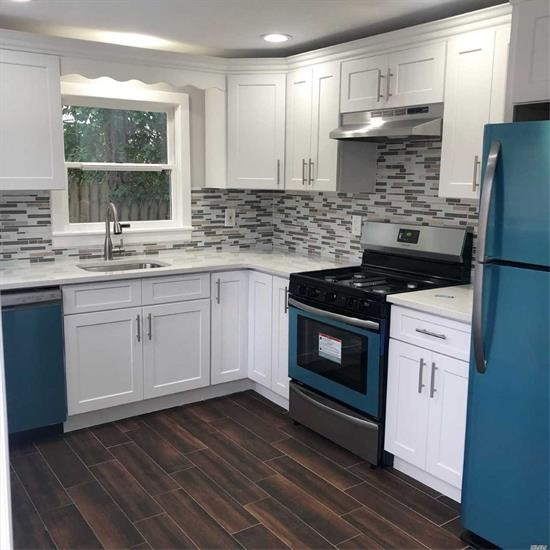 Totally Renovated Spectacular 3 Bedroom Expanded Cape Features Custom Kitchen S.S Appliances, Granite Counter Tops, Over Sized Custom Bathroom. Living Room With Cathedral Ceilings. Walk To Lake. Large Deck For Entertaining
