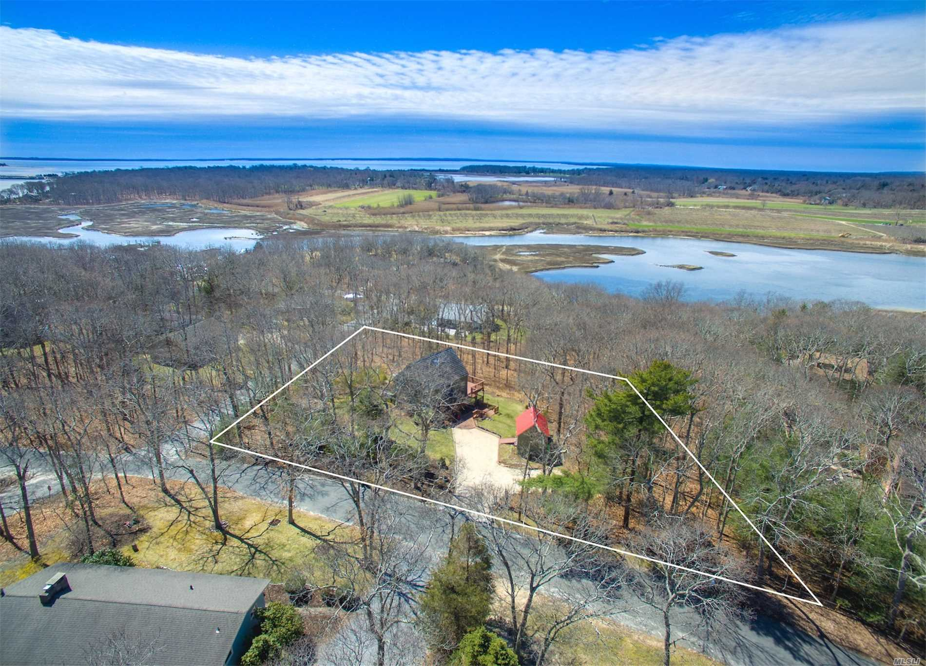 Amazing Fleets Neck Opportunity w/ Elevated Water Views Of Wickham Creek Rests This Corner Lot Home. Very Private Yard w/ Room For A Pool. Lower Deck Off Basement w/ Outdoor Shower & Elevated Deck Off Of Main Living Area. All Post & Beam On Interior, 1/2 Bath On Main Level, 2 Large Bedrooms Upstairs Along w/ Full Bath. Walk To Beach, Dave Allison Park & Commercial Marina. You Have To See This One In Person. Special Home, Property & Location!
