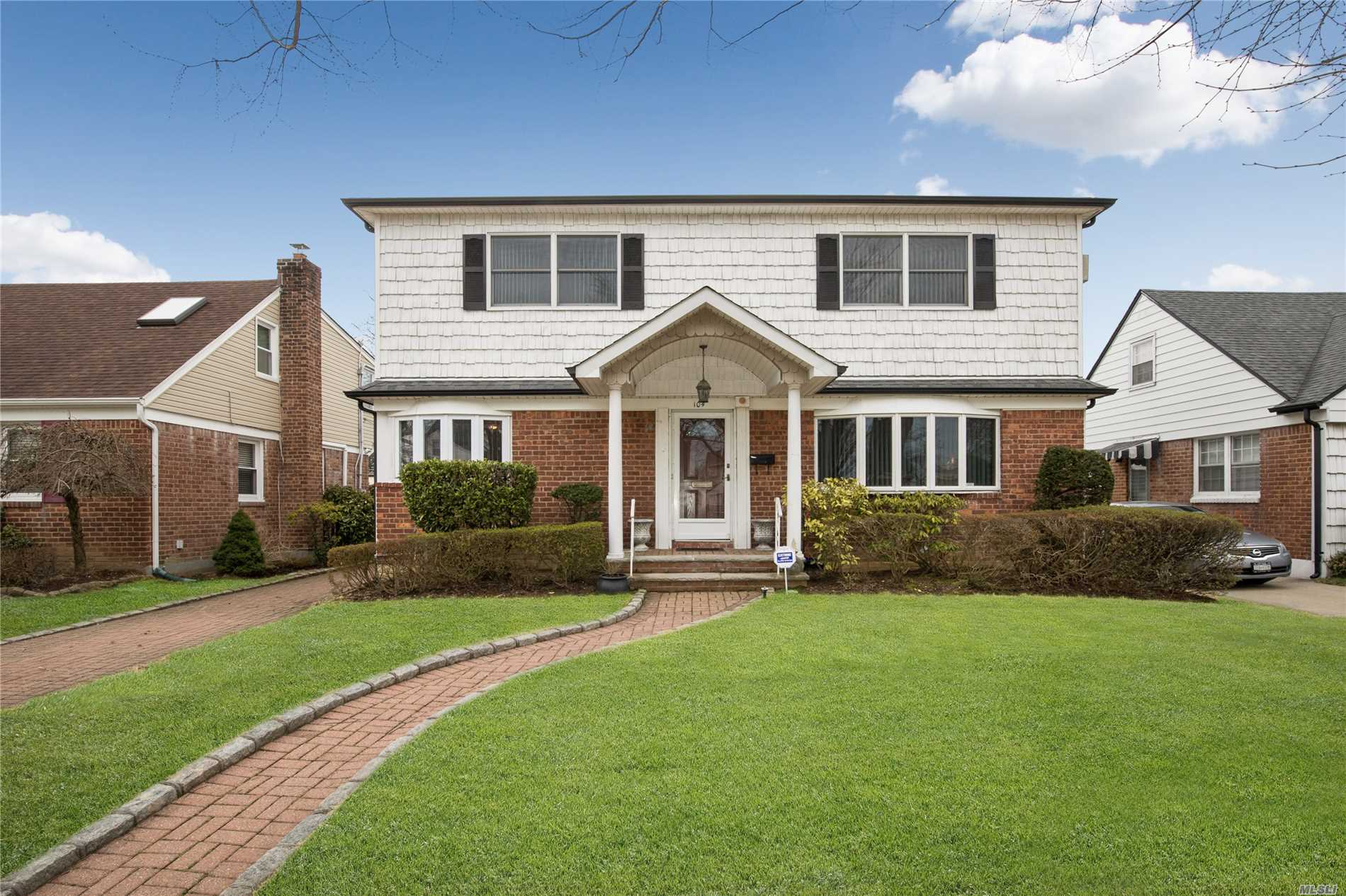 Majestic Colonial in the Manor! This Sprawling Colonial Offers Spacious Rooms With Oversized Formal Dining Room, 5 Bedrooms and a Large Oak Eat-In Kitchen. Enclosed Rear Porch Leads To Private Yard With Brick Driveway!