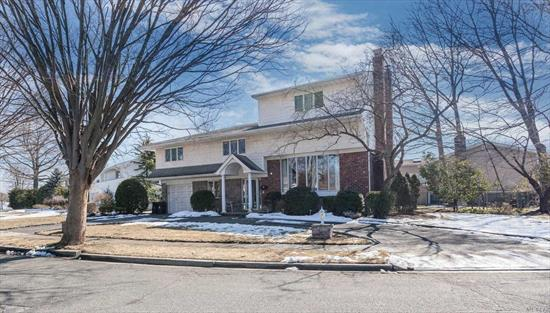 Beautiful 5/6 Bedroom 3.5 Bath Split With Expanded 3rd Floor, Which Adds 2 Bedrooms and a Bath. High Ceilings, Hardwood Floors, Spacious Rooms. Custom EIK With Wood Cabinets, Granite & SS Appliances. Living Room & Family Room Each With Fireplace. Generous Closet Space, French Door to Deck, Andersen Windows, CAC, IGS, & Garage.