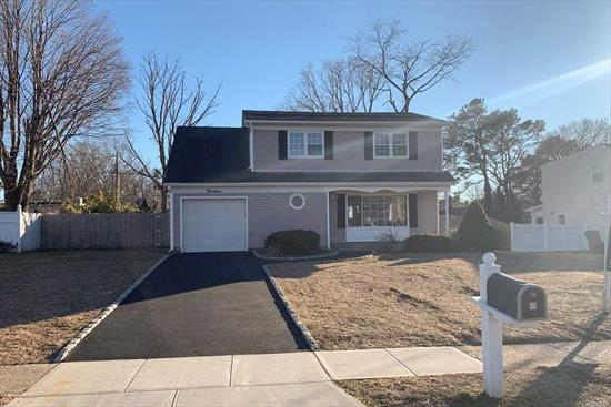 Spacious House with wooden floors. New siding, new boiler, new gutters, Completely new Kitchen and Granite countertop with stainless steel appliances.