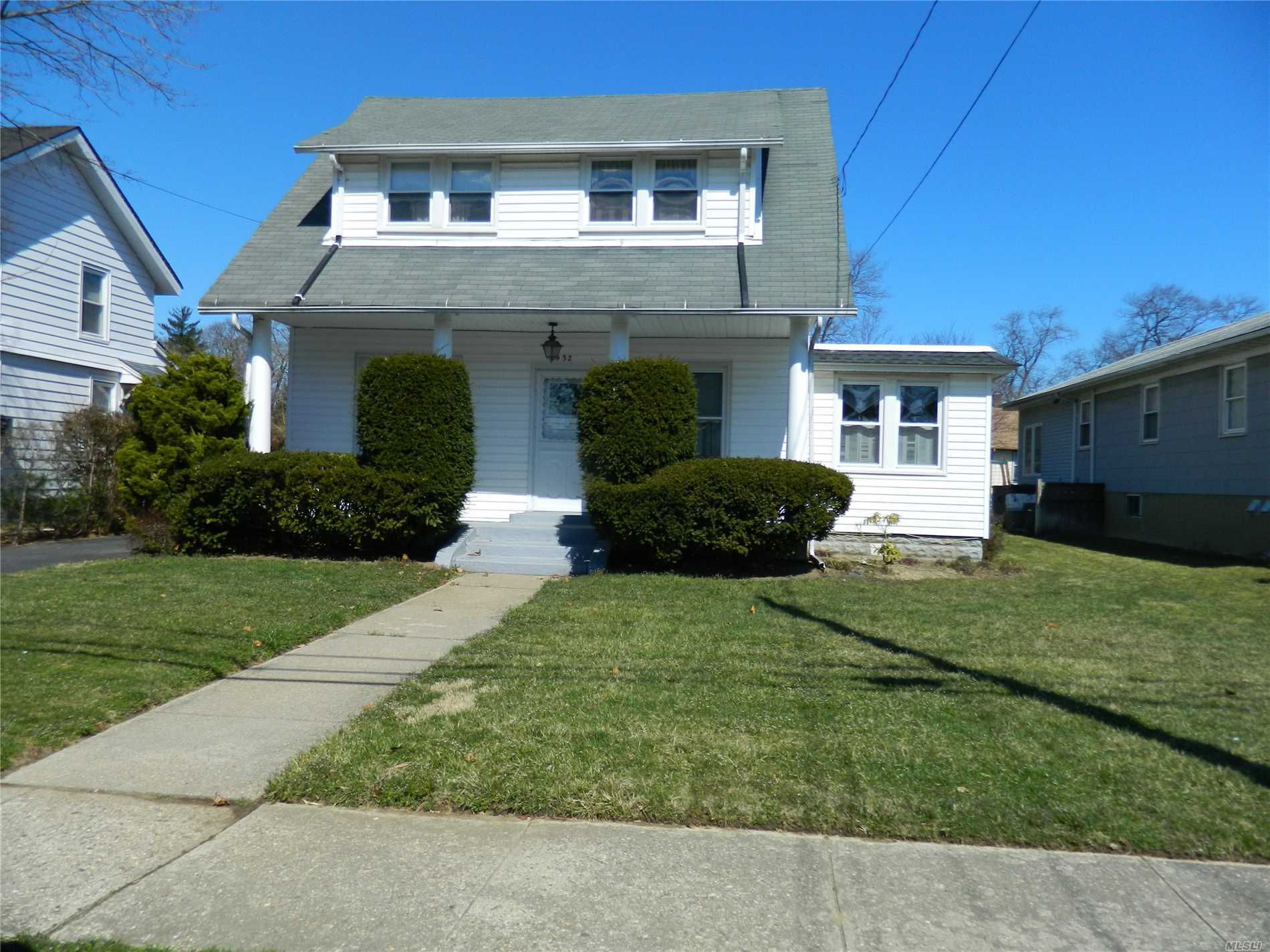 Charming 4 Bedroom Colonial Home with high ceilings, large backyard, and hardwood floors throughout! Sold as is.