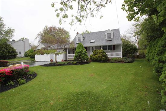 Welcoming Expanded bright, light-filled Cape with 4 brs, 2 baths, FLR, EIK, FDR (17 x 15), with gorgeous hardwood floors throughout. Sunroom (17 x 13), full basement with OSE on a .25 acre flat pvc-fenced yard. Enjoy cooking with family in the kitchen, entertaining friends in the sunroom , relaxing on the back porch, BBQing in the yard. Park up to eight cars on the drive during parties and holidays. Newer Split AC systems make house feel like it has Central Air. Make this one yours!