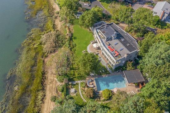 Bayville. Impressive waterfront home with 290' on Mill Neck Bay. An entertainer's dream, this 5, 500 SF approx. Contemporary boasts panoramic water views from most rooms, an open sun-filled layout, soaring ceilings, indoor spa, multiple outdoor sun decks, and many high end custom details. Gorgeous heated pool with pool house on a beautifully manicured acre. Serene and private location, yet close to all.