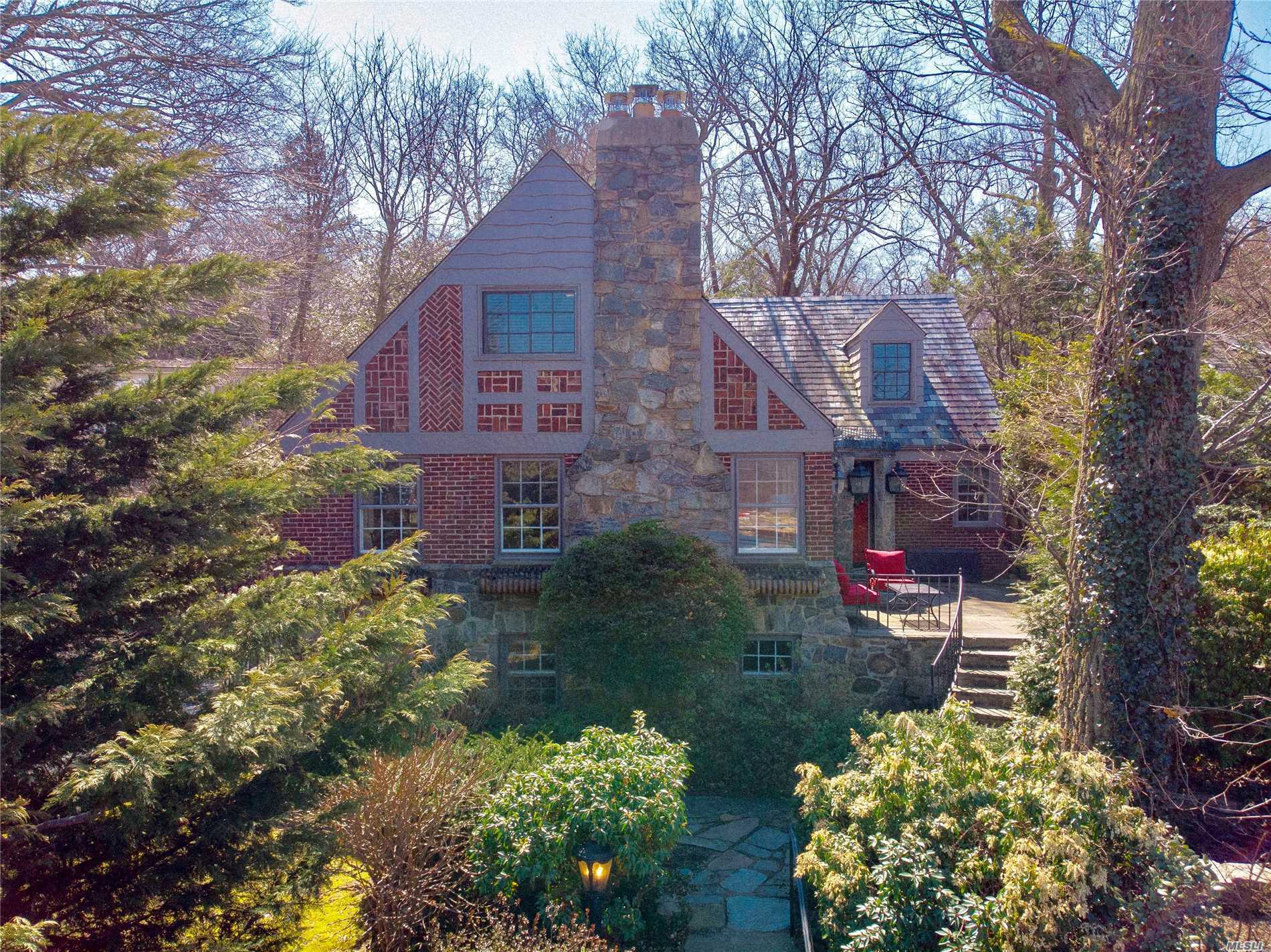 Charming Brick Tudor w/Waterviews Located in the Best Spot above Hempstead Hbr & Below The Village! Easy Access to All! Open, Airy & Happy Define this Beaut.Maintained Home. Great Flow For Entertaining!Slate Roof, Redone Oversized Gazebo & Sports Court.Lower Level Adds a Whole Other Dimension..1st Flr Oversized Master Suite & Gourmet EIK w/Wolf Range & Sub Zero Frig. CAC 1sL Flr.Lots of Backyard Space for Entertaining & Fun! Close to SC Beach, Restaurants, Sunsets & Music