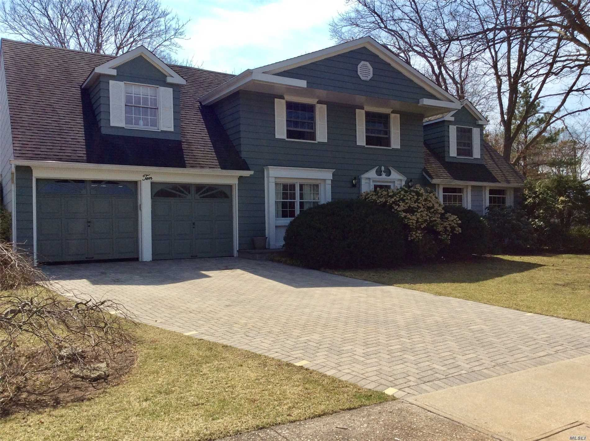 Beautifully appointed 4/5 bedroom center hall Colonial boast expansive size principal rooms, open floor plan, wood flooring throughout entire home, custom moldings, freshly painted , Huge family room with wood burning fireplace, 2 car garage, Bsmt situated on a cul-de-sac & much more.