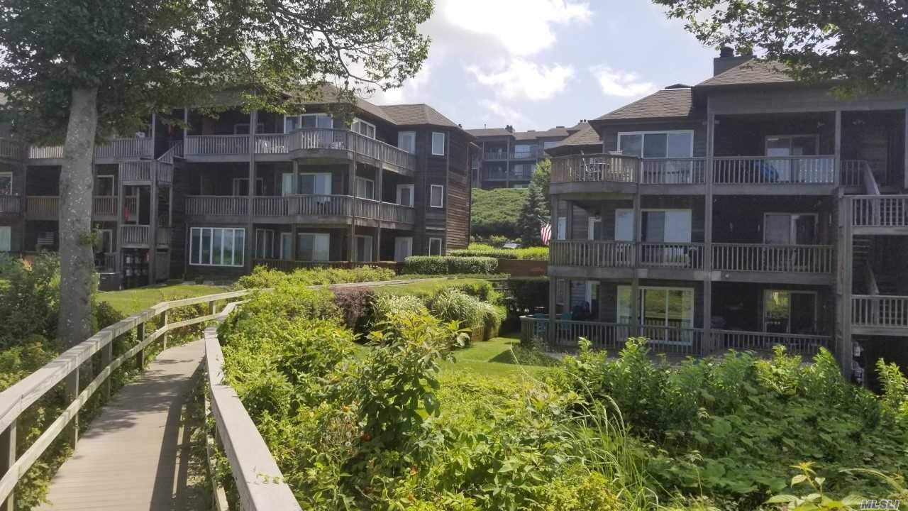 Desirable Sound Front End Unit In The Bluffs Easy Beach Access. Beautiful & Beachy Clean Unit W/Hardwood Floors And Wrap-Around Sliding Doors All Open To Large Covered Deck Overlooking Rolling Lawns & Water Views. Large Open Living/Dining Room Combo with Wood-burning Fireplace. Eat-In-Kitchen W/Laundry & Breakfast Bar. Large Master Bedroom Suite. Complex With Community Pool & Tennis.