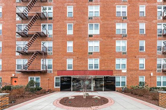 Beautiful spacious true 2BR Co-op apartment. Great layout and bright sunny corner with 3 exposures. Modern EIK and bath. Shows well. Convenient to LIRR, Bell Blvd, 3 blocks to shops and restaurants. New windows, new elevator.