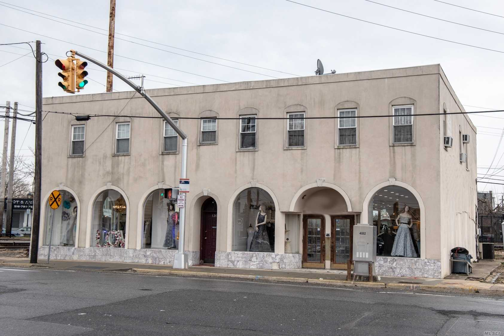 Mixed Use building for sale. Store front, could be subdivided. The 3 upper level apartments, fully rented. Month to month, tenants would like to stay. Great accessibility. Train station 1 block away, bus stops in front, municipal and street parking available.