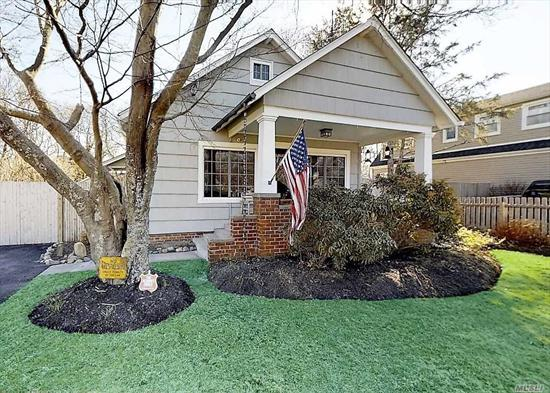 Charming craftsman style cape with 3 bedrooms and 1.5 baths in prime location. This mint home has beautiful wood floors, gas fireplace, upgraded kitchen, custom woodwork and built-ins, full basement, new roof and detached garage in fenced yard. Close to village and Moriches Bay, low taxes!