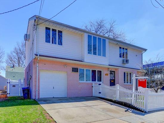 Beautiful, spacious and bright home in great location in the heart of Floral Park. Hse on a 60x100 lot, features 6 bedrooms, 3 full bath, kitchen, huge LR, formal dining, attic, full finished basement and 1 car garage. Huge backyard and a beautiful deck too. Great for a large family with excellent layout. Close to schools, transport and conveniences. Must see to appreciate!