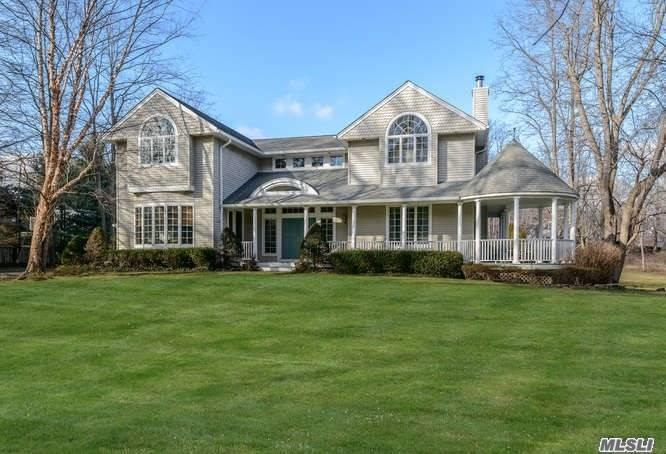 Updated Clapboard Colonial in Beach Community with Front Porch and Gazebo. 10' Ceilings, 2 Fireplaces, French Doors, Gas Cooking in a Gourmet Kitchen, Office, Master Suite w/Spa Bath, Central Vac. 50' Heated Pool, Patio, Deck and Pond plus Whole House Generator & 3-Car Garage. Peaceful & Picturesque. Enjoy Lattingtown Harbor Lifestyle! LI Sound Beach with Beach House. Glen Cove Golf Course. Amazing!