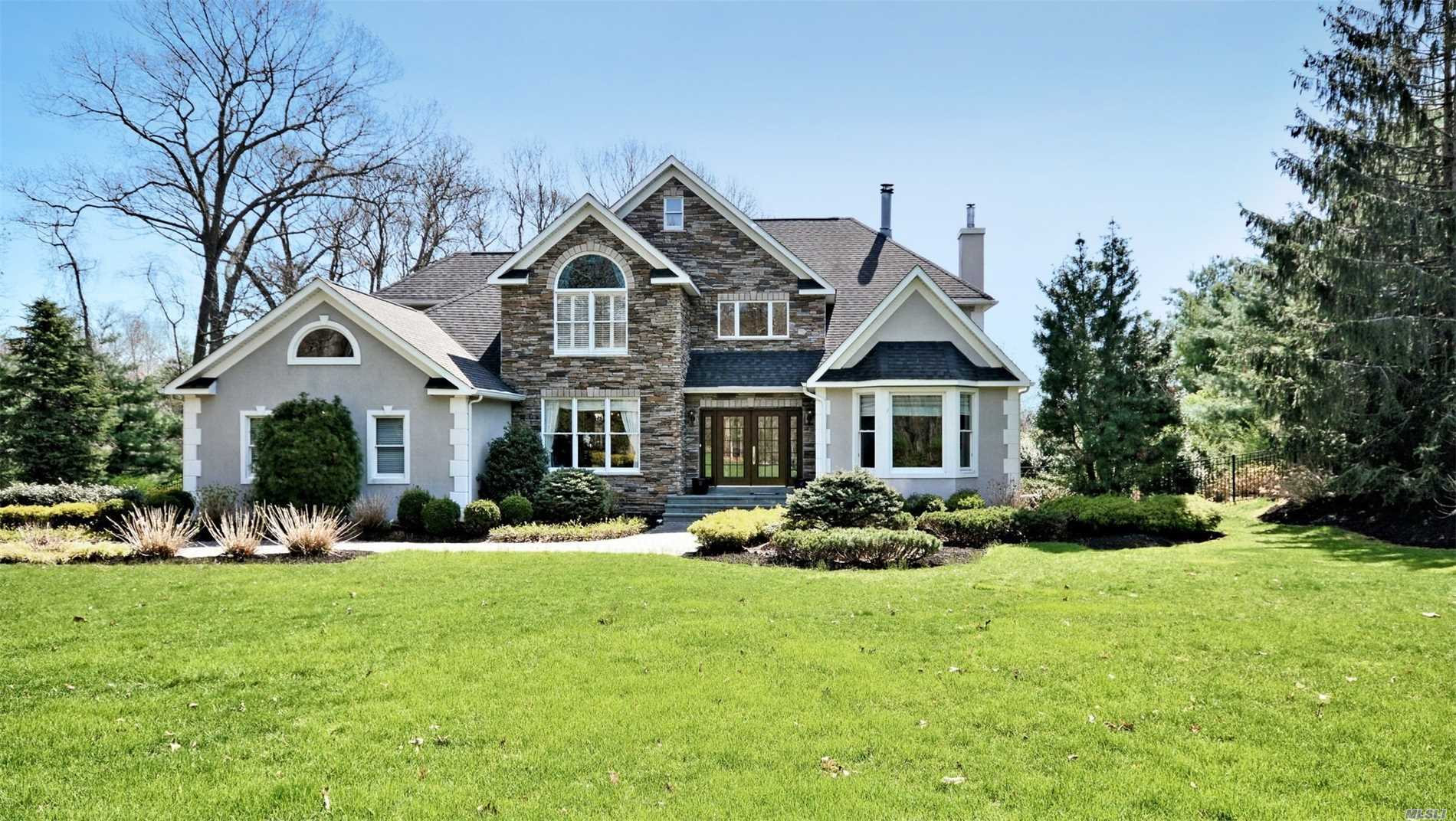 This Exquisite Home Is Beautifully Placed In A Private Country Club Setting With A Salt Water In Ground Pool, Patios, Porches And Decks! The Interior Is 3 Floors Of Living Space With Plenty Of Room For Extended Family With A Walk Out Lower Level With a Summer Kitchen! Wood Floors, Dual Fireplace, Large Rooms, Walk In Closets, Updated Kitchen, Steam Shower, Bubble Jet Tub And More! A Must See!