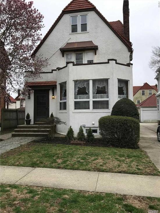 Very Large well maintained Home on a with 5 Bedrooms 4 baths piano room and plenty of light with basement total of 4 floors.