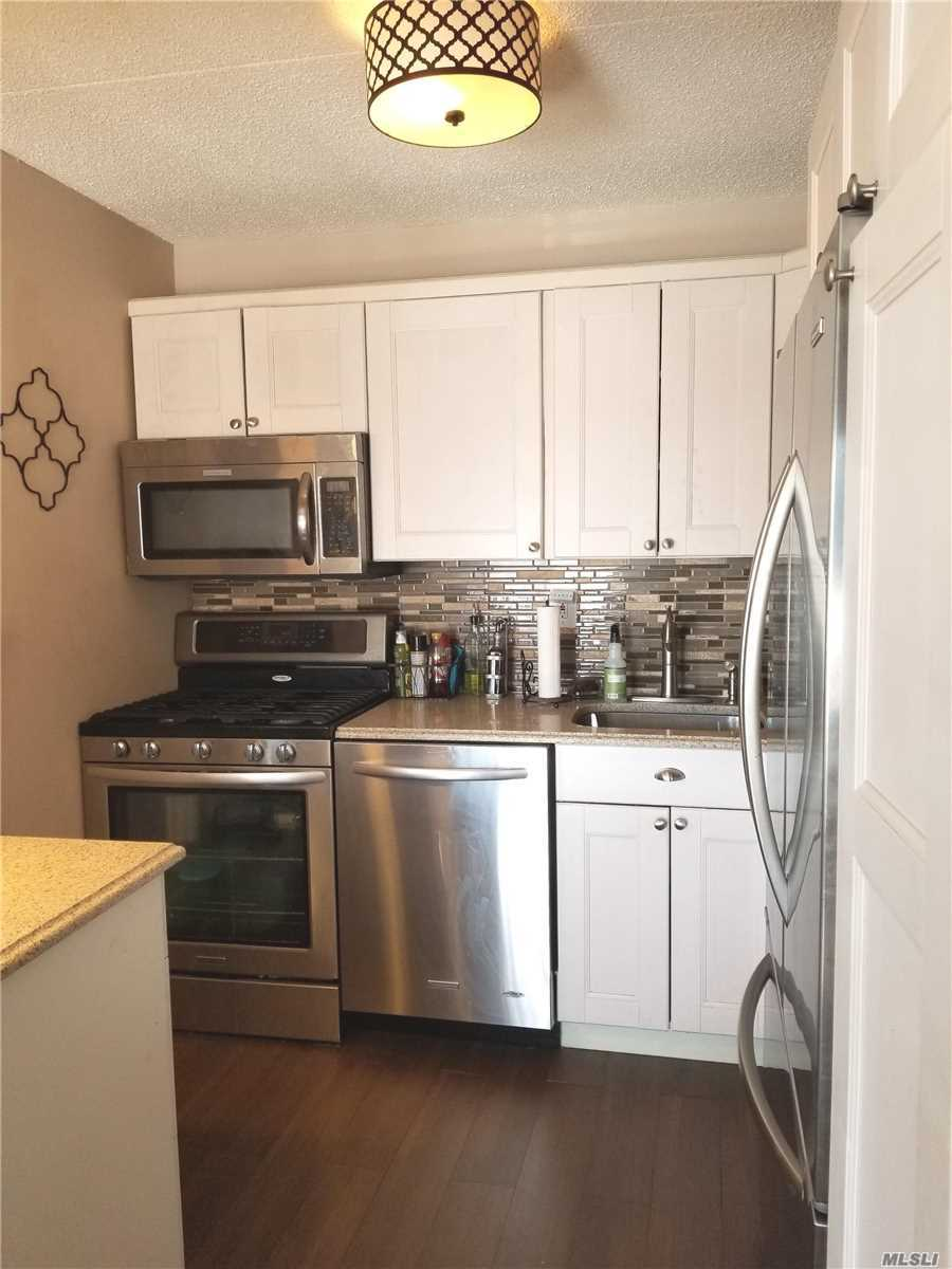 Renovated unit in Gated community with water & city views, close to McNeil Park. 2bd/2bth unit w/ Lg terrace,  stainless steel app. Alarm, Wood tile floors, plenty of closets, W/D in unit. Att. 1 car garage & spot.