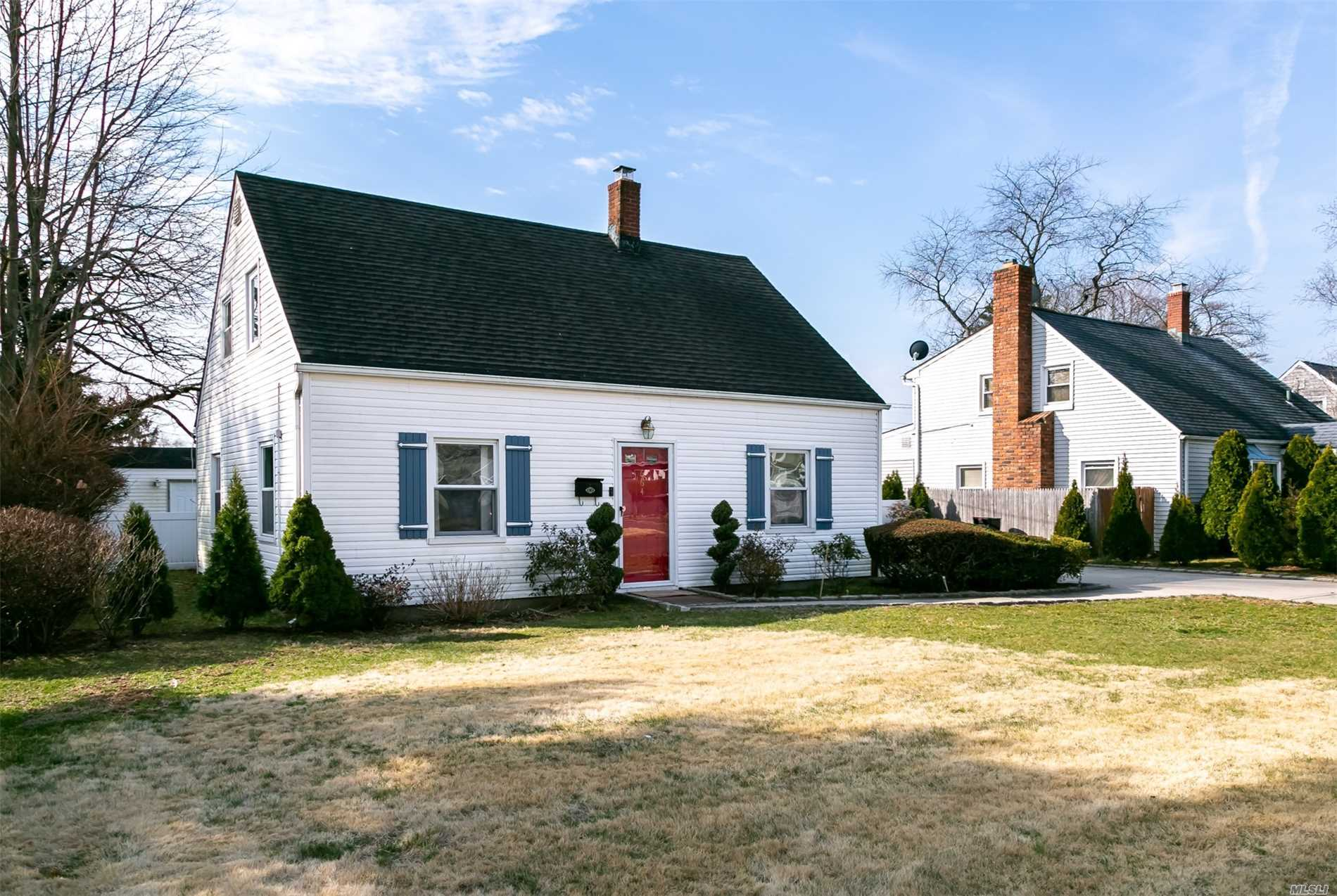 Expanded Cape Located on a Quiet Dead End Block with a Rear Extension. This house offers either a Formal Dining Room, or a Large 5th Bedroom. Updated Kitchen and Baths. Plenty of Possibilities. Low Taxes with STAR $7183