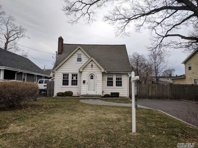 Charming Cape On A Generous Sized Property. Quiet, Mid-Block Location W/ Seaford School District! Wood Floors Throughout Living & Dining Room W/ A Stone, Wood Burning Fireplace. Needs Your TLC & Personal Updates To Make It Home Sweet Home. Great Neighborhood To Reside In So Don't Miss A Great Opportunity!!