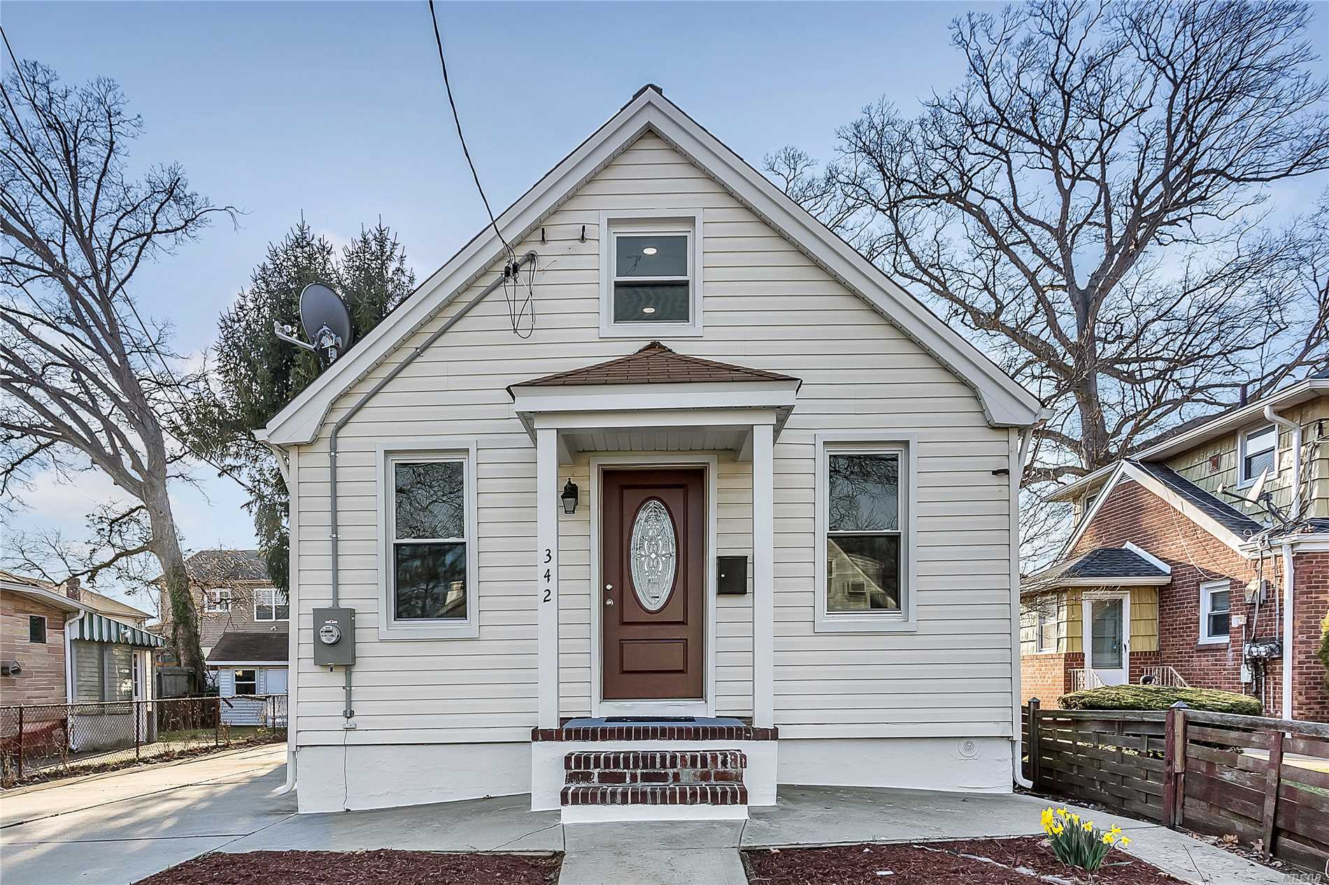 Beautiful gut renovated house in Elmont! All new plumbing, electric, tankless navien boiler, new windows, new kitchen, new Bathroom, new floors etc.. LOW TAXES.