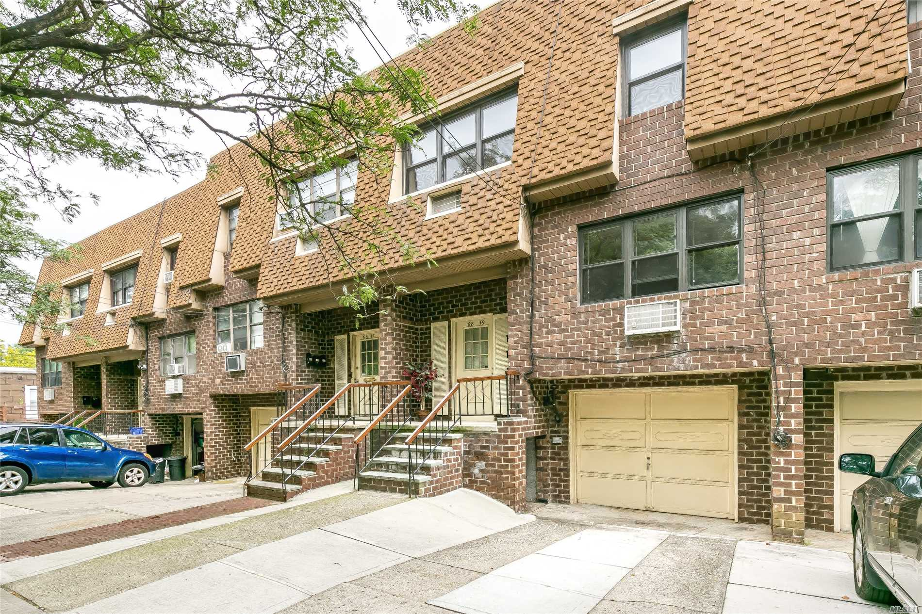 Brick Legal Two Family Condo In Excellent Condition. Convenient Desirable Location Near Supermarket, Shopping And Major Expressway. Large 3 Bedroom Apt Over 2 Bedroom Plus 1 Bedroom Walk-In. Hardwood Floors Throughout. Great Property For Both Family And Investment Use. Top School District #26.