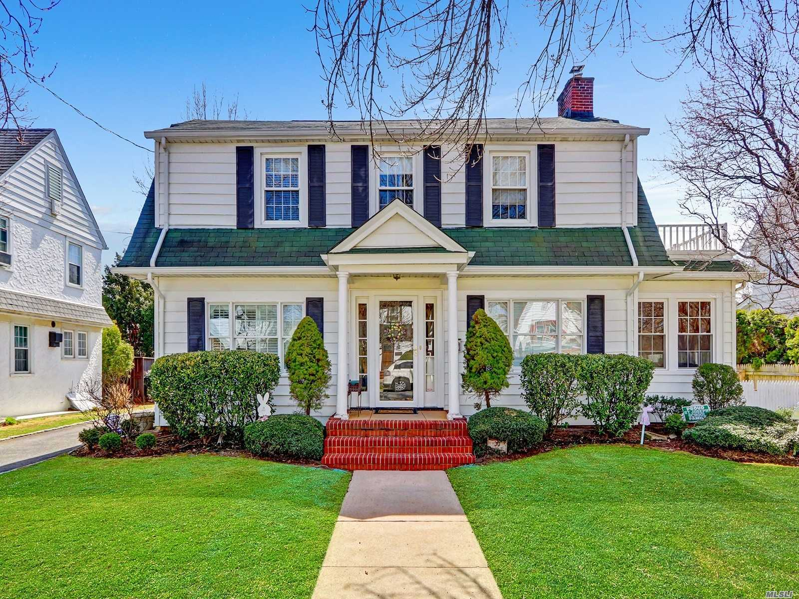 Desirable Dutch Colonial on Tree-Lined Street in the Heart of Cathedral Gardens. Perfect for Entertaining, New Kitchen, Updated Baths. Backyard is private with patio and 2-Car Detached Garage. CAC,  New Windows and Driveway.