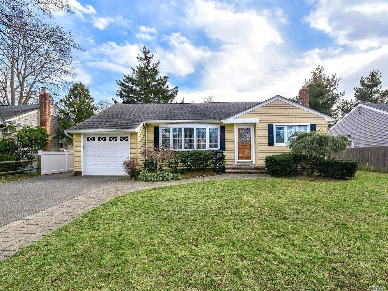Beautiful Wantagh Woods spacious Ranch featuring large Living Room, totally decked-out Eat-in-Kitchen, stunning back yard with brick patio & hot tub area. Top location! Walk to shopping, schools, transportation.