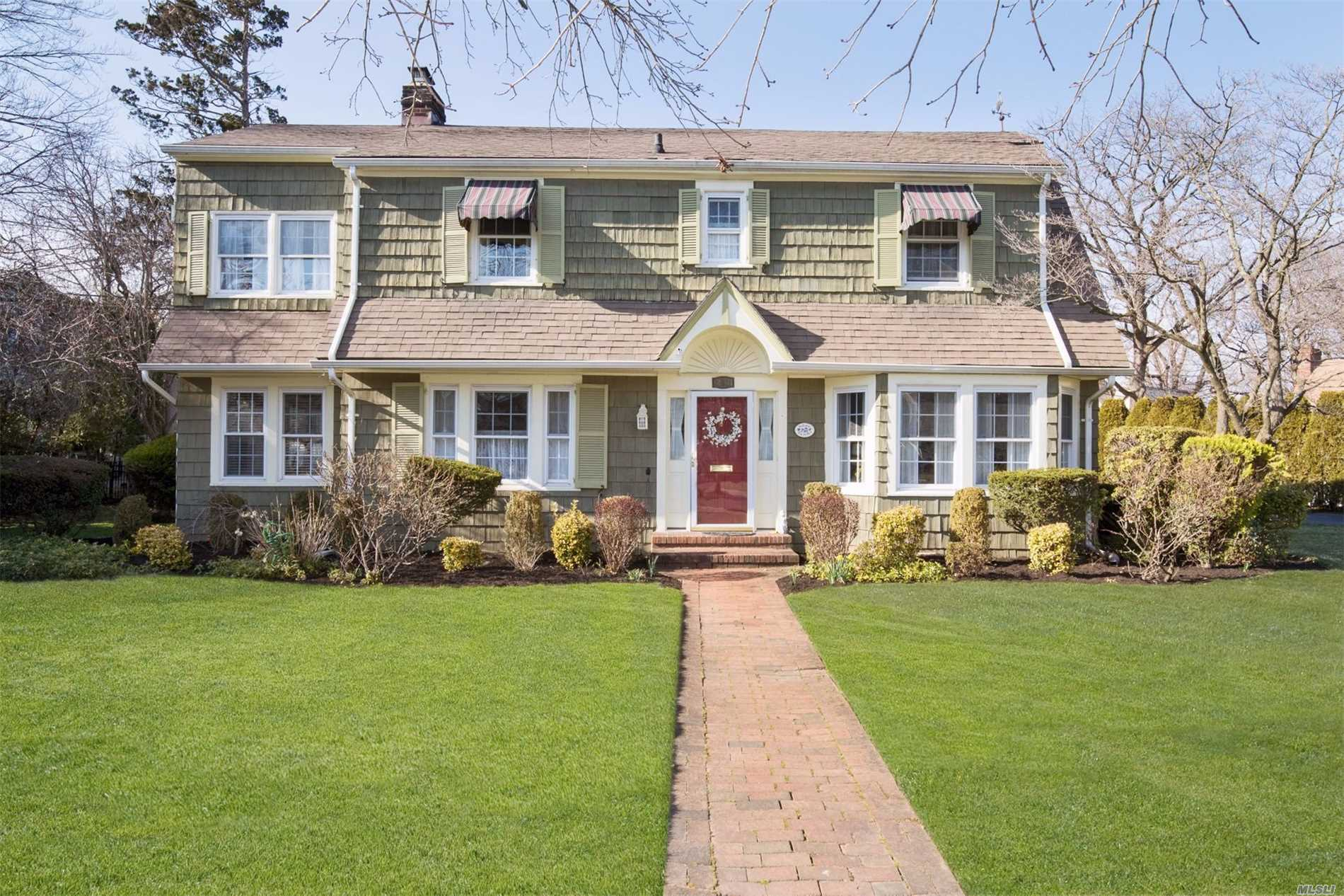 Lovely Colonial on large parcel in Bryn Mawr section, Wilson schools. Entry hall divides large living room with fireplace, adjoining family room, and a Large and sunny dining room. Eat-in Kitchen, white cabinets, granite countertops, adjoining laundry room, powder room. Outside entrance leading to relaxing deck overlooking large and lush landscape. Upstairs is large master suite, 1 bedrooms, and 2nd bedroom with adjoining tandem room, and full hall bath. Finished basement with wet bar.