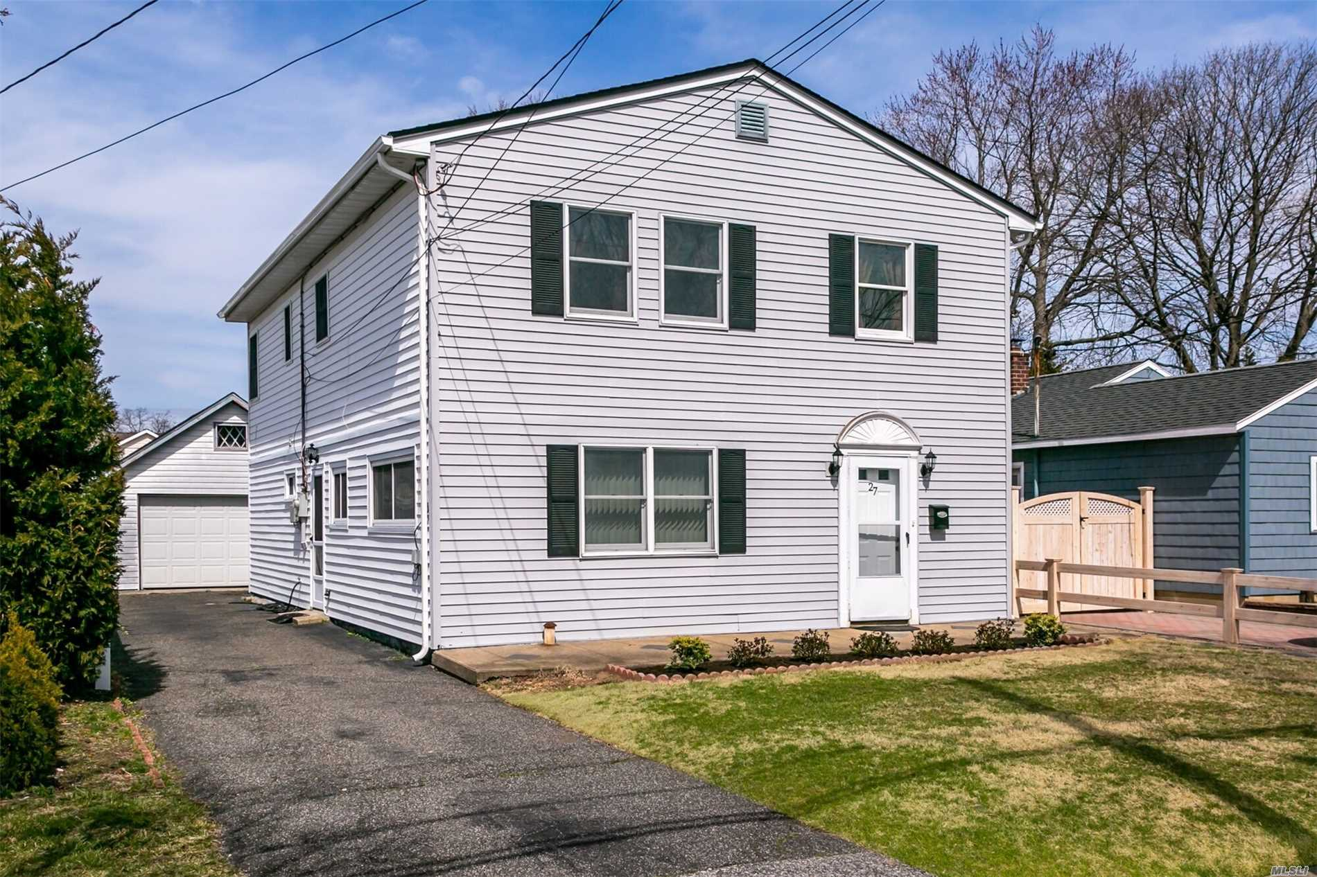 Spacious Expanded Ranch situated Mid-block. Brand New Roof, Updated Kitchens and Baths, Detached 1.5 Car Garage. All Large Rooms, New Carpets in Upstairs Bedrooms, Possible Mother/Daughter with proper permits.  New owners must apply.