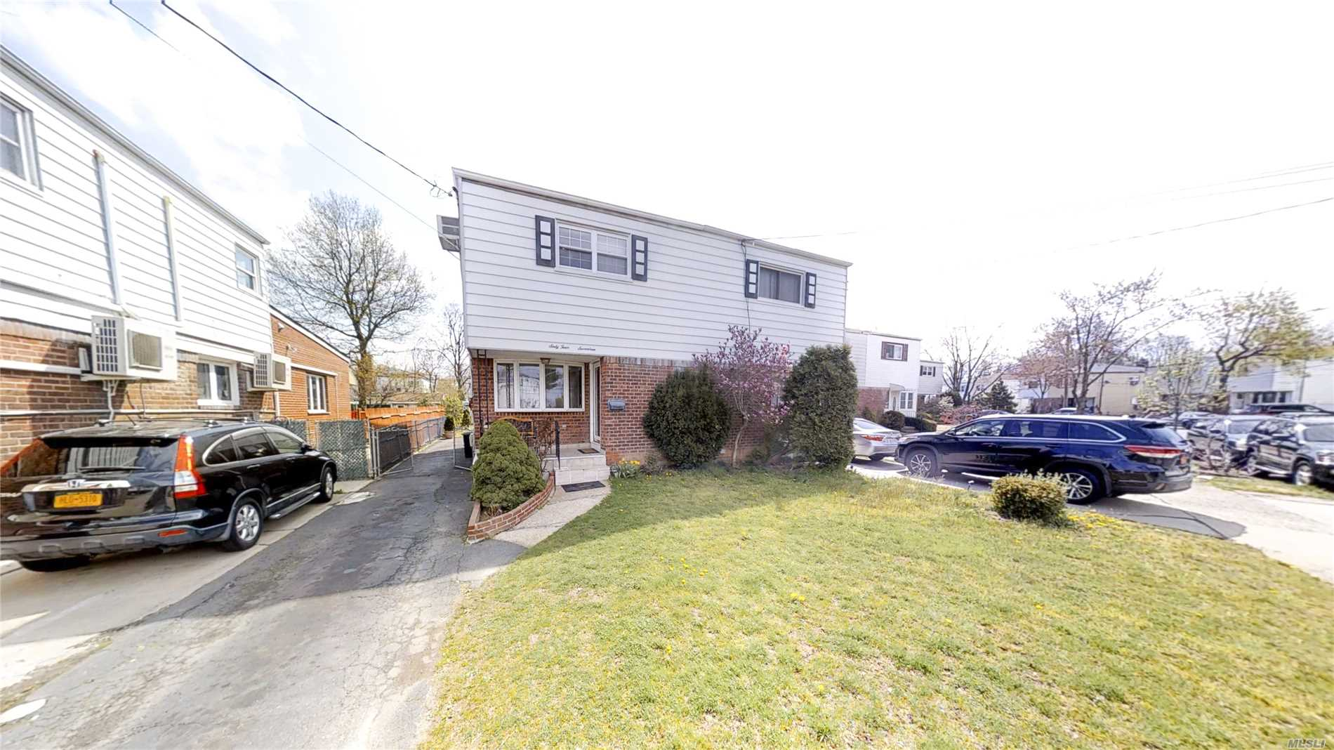 Move in condition, High-quality wood floor, Large back yard with deck, finished basement with laundry room. Quite neighborhood steps away to Main St,  Minutes to Restaurants, Supermarket, and downtown Flushing. Easy access to 495 expwy