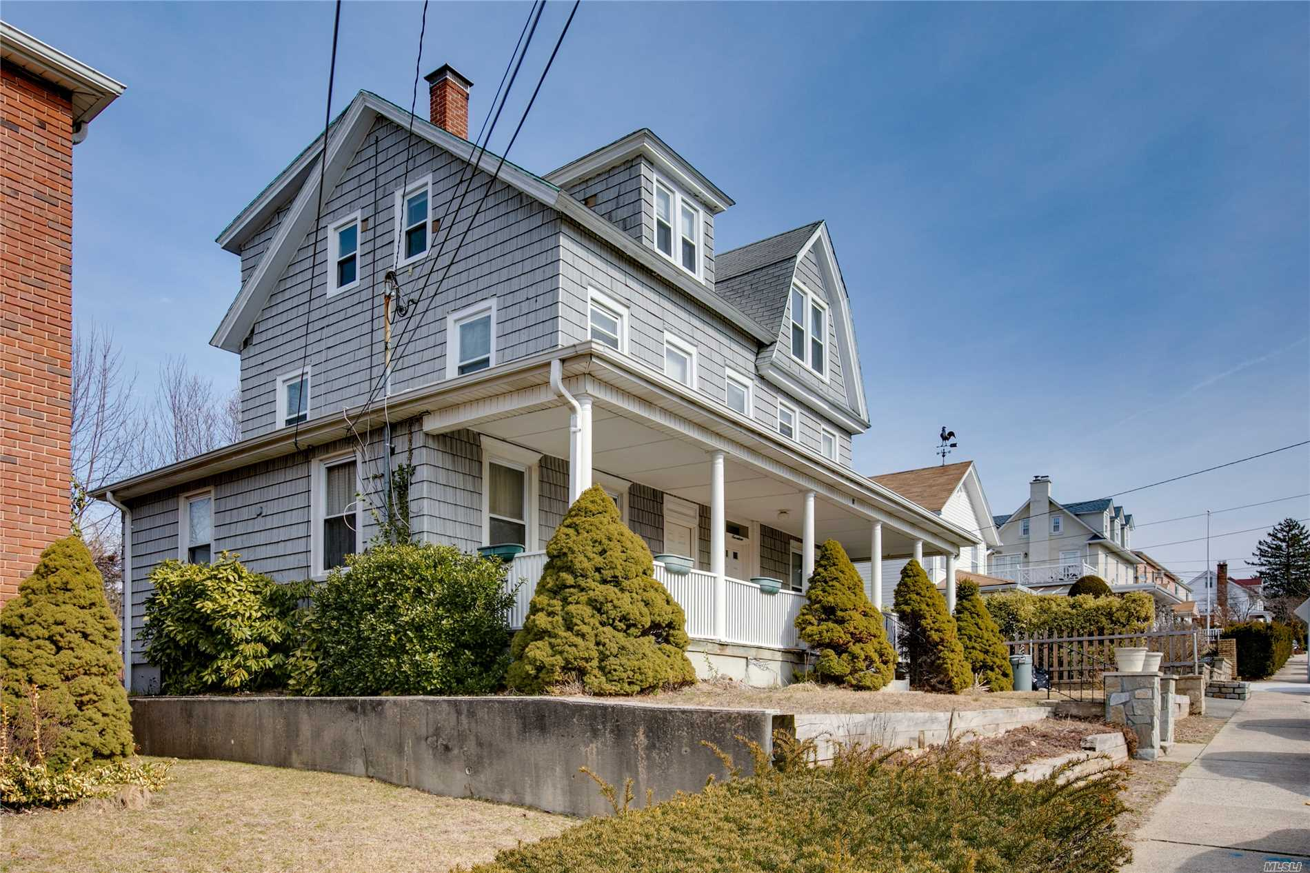 Arts And Crafts Two Family 19th Century Home With Charming Rocking Chair Porch. This 2 Family Is Located Close To Town And Harbor And Manhasset Bay. Beautiful Views From Top Floor. Needs TLC. Can Be A Great Investment Or Restored Back To A Grand One Family Home. Water views from 3rd floor