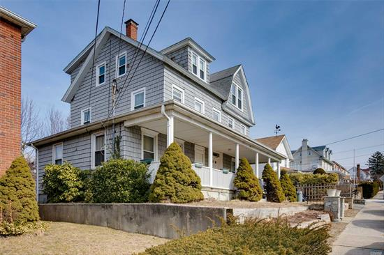 MAJOR REDUCTION !! PRICED TO SELL AS IS!  GREAT OPPORTUNITY Arts And Crafts Two Family 19th Century Home With Charming Rocking Chair Porch. This 2 Family Is Located Close To Town And Harbor And Manhasset Bay. Beautiful Views From Top Floor. Needs TLC. Can Be A Great Investment Or Restored Back To A Grand One Family Home. Water views from 2nd & 3rd floors